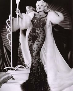 Photo 11: Due to the Great Depression in 1930s, people begin to low their cost by wearing mass production clothes. The high fashion become only avaiable for actress in Hollywood. This picture is Mae West in an Elsa Schiaparelli creation , standing next to an art decro object