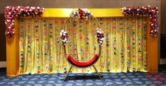 Floral decor with colourful paper parrots backdrop. Naming Ceremony Decoration, Wedding Stage Decorations, Engagement Decorations, Decor Wedding, Diy Backdrop, Backdrop Decorations, Cradle Decoration, Cradle Ceremony, Flower Garland Wedding
