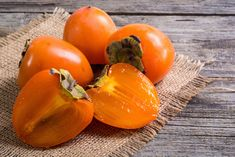21 Health Benefits of Persimmons & Nutrition Facts Persimmon Fruit, Natural Solutions, Health Benefits, Nutrition, Canning, Vegetables, Food, Wooden Background, Fruits And Vegetables