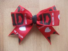One Direction hair bow by xVoodooLilyx on Etsy, One Direction Logo, One Direction Outfits, One Direction Concert, Cheer Outfits, 1d And 5sos, Cheer Bows, Harry Styles, How To Look Better, Trending Outfits