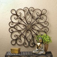 SCROLLWORK WALL DECOR Give your wall a dramatically stylish makeover simply by hanging this impressive iron decor. Curling waves of wrought iron wisp and wander from the center metallic ornament to make a modern statement. Wrought Iron Wall Decor, Metal Wall Decor, Diy Wall Decor, Wall Decorations, Toilet Paper Roll Art, Toilet Paper Crafts, Diy Wand, Mur Diy, Decoration Shabby