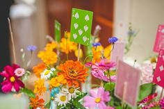 Playing card + flower centerpieces (maybe a favorite family card game deck like Uno?)