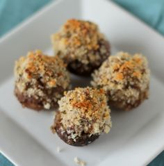Baked mushrooms stuffed with italian sausage and cream cheese and topped with a crunchy blend of panko and parmesan
