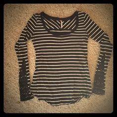 Free People Long Sleeve Striped Top Free People Long Sleeve Top - Black and White Stripes. Crocheted detail on sleeves.  One of the little buttons is loose on left sleeve (see pic 3). Free People Tops