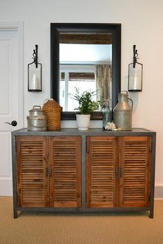 Love this cabinet - I think I could possibly replicate it from a steel table and wooden slat shatters or bi-fold doors