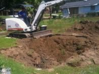 One advantage of a dumpster pool is that it only needs approximately a 8x24 feet space which is perfect for shotgun houses with narrow lots. This lot had a 2-3 foot decline so Beese had to excavate 24 inches to level the location for the installation.