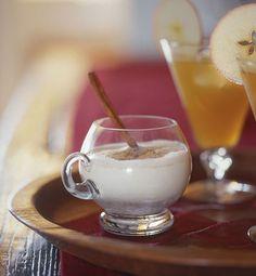 Boston Eggnog with Cardamom Recipe Beverages with ice cubes, whole milk, brandy, amber rum, Madeira, large egg yolks, sugar, ground cardamom, grated nutmeg, cinnamon sticks