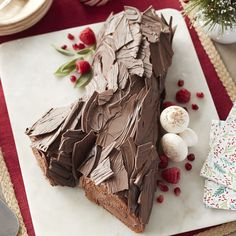 Add a traditional and delicious Yule Log cake to your dessert table this Christmas.  This recipe calls for rich rolls of chocolate cake with a delicious hazelnut filling, all bundled into a beautiful log covered in Cocoa Candy Melts bark. It's a show-stopping centerpiece to impress your guests and Yule love just how tasty it is!