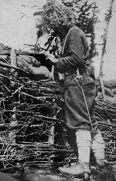 WWI soldier with camouflaged helmet