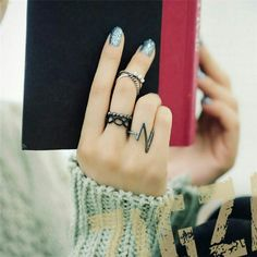 Punk Ring Set Price is for all 4 rings I am not aware of the metal  Thank you! Jewelry Rings