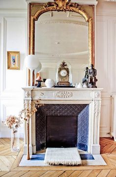 This french mirror makes this room! Fabulous Detail, South Shore Decorating Blog: Fireplace Mantels, Oversized Mirrors