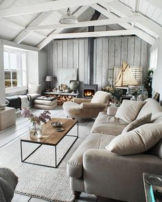 "A Living Room the Color of the Winter Sky -- Neutral linen sofa and chairs, exposed beams in the ceiling, natural area rug and wood accents combine for a cozy, casual look. See how you can shop the look here on ""Room Crush: Serene Gray Living Room "" over on the One Kings Lane Style Guide!"