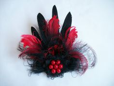 Black and Red Feather Brooch Order Now from Gothic Diva Designs Specialising in Fabulous Elegant Gothic, Victorian Vintage & Steampunk inspired wedding designs, Including mini hat fascinators, formal hats, feathered hair clips, ostrich & peacock feather