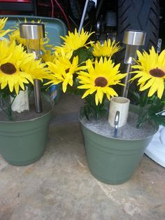 Homemade 10# awning pole stabilizers for the camper, with solar lights. Full build details:  http://fromthealdergrove.net/2015/07/26/awning-pole-flowers-camper-mod/