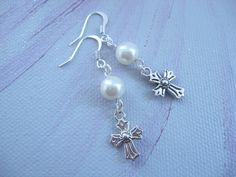 Earrings +*Cross*+ made of white glass beads, and a beautiful cross silver colored.   The pattern of the cross is on both sides. Matching charm i...