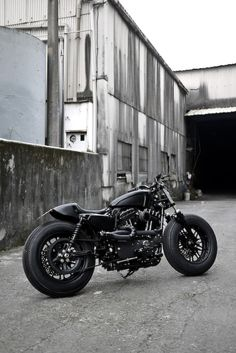 "The Bomb Runner, by Rough Crafts.  An ""iron guerrila"" based on a 2009 Harley-Davidson Iron 883 Sportster."