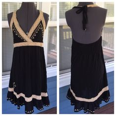 """BLUE ISLAND Black with Crochet Lace Halter Dress Stunning!BLUE ISLAND Black Halter Dress.  Crochet lace adorned.  Embroidered detail.   Elastic gathered back.  Black Rayon material.  length 35"""" (shoulder to hem).  Excellent condition. Blue Island Dresses"""