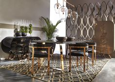 Living Room | Black leather meets stainless steel frames with these fabulous Joplin dining room table and Art dining chairs by Kelly Hoppen MBE.