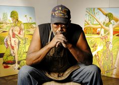 LONG BEACH - In his studio on Atlantic Avenue, artist Akinsanya Kambon flips through a stack of paintings depicting his experiences in Vietnam.Each scene is more horrific than the next.