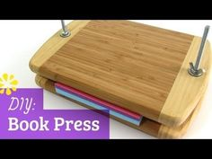 "In this tutorial, I'll show you how to make your own book press with affordable materials that are easy to find.    Materials Used:  2 - 9"" x 12"" Eco Smart bamboo cutting boards  2 - 1/4"" x 5"" carriage screws  2 - washers  2 - 1/4"" wing nuts    Visit my channel for more DIY - http://www.youtube.com/sealemondiy    SUBSCRIBE FOR MORE TUTORIALS - http://bit...."