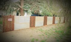 A fence we dreamt up and made out from mostly reclaimed materials