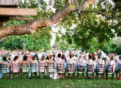 Fabulously color coordinated head table - the bridesmaids in pastels and the groomsmen sport matching suspenders!