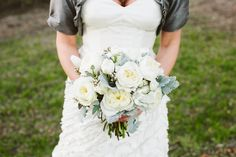 CHARLESTON WEDDINGS - Boone Hall Plantation Winter Wedding bouquet with a silver color palette. Photographer: Riverland Studios  / Hair Stylist: Whispers on Wentworth  / Caterer: Newton Farms Catering  / Floral Designer: Charleston Flower Market  / Reception Venue: Boone Hall Plantation  / Dress Store: Fabulous Frocks  /  Cake Designer: WildFlour Bakery  / DJ: Other Brother Entertainment  / Makeup Artist: Pamela Lesch Makeup  / Transportation: CHARLESTON BLACK CAB COMPANY