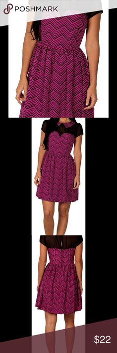 """Junior's Paper Doll Dress Item Information:   Go out in style with this printed illusion dress by Paper Doll. Chic and ultra-feminine, this darling dress is worth raving about. Featuring an on-trend zigzag pattern, a playful Peter Pan collar a flirty, sheer neckline and cap sleeve, it promises to define a stylish ensemble. Zip and button back. 100% Polyester. Machine wash.  Description:  Junior's Printed illusion Dress by Paper Doll          Size:   Size 3- Bust 30"""", Waist 23"""", Length 33""""…"""
