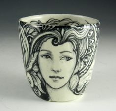 black and white porcelain cup with mermaid and faces