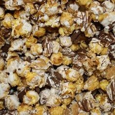 S'mores Popcorn - Delicious Caramel Popcorn, graham cracker bits and Hershey's chocolate bars drizzled with marshmallow fluff & milk chocolate!