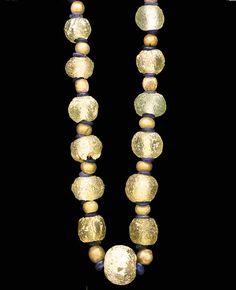 A ROMAN GLASS BEAD NECKLACE CIRCA 1ST-2ND CENTURY A.D.