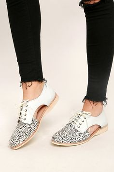 Give the ol' razzle dazzle in the Rollie Sidecut White Snow Leopard Leather and Pony Fur Oxfords! Leopard print pony fur makes a statement over the almond toe, while off-white leather, cutout accents, and a lace-up vamp complete the look. Available in Euro sizes 36-41.