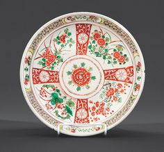 "Chinese Famille Verte Porcelain ""Four Seasons"" Dish, probably 17th c., interior painted with a central flower head encircled by radiating panels of prunus, peony, lotus, and chrysanthemum, exterior with flower sprays, base marked, h. 2 5/8 in., dia. 14 1/8 in."