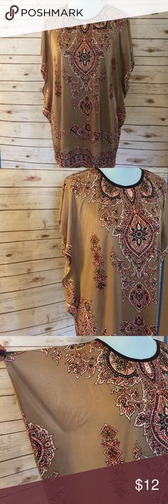 Boho Blouse Nice and cool boho blouse in modern earth tone colors of beige, brick, brown, black and cream. Black trim around neck of blouse. Never worn, just hanging around in my closet. Tops Blouses