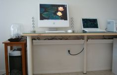 Cord Management with rain gutters -this is great for keeping the cords off the floor and the desk
