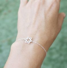 star of david bracelet - tiny jewish star - sterling silver sideways star of david . jewish jewelry , magen david bracelet .. $24.00, via Etsy. Okay james, I want this too baby!