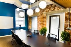 office conference room, globe light fixtures  #commercial #buissness #design #interiordesign #conference #conferenceroom #hhi #henriettaheisler #interiordesign #remodel #lights #chandiliers #hangingpendant #blue #modern #white #table #chairs #meetingroom #coveceiling #ceiling #brick #raw #rustic #door