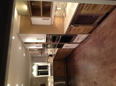 White lacquer and wood cabinets