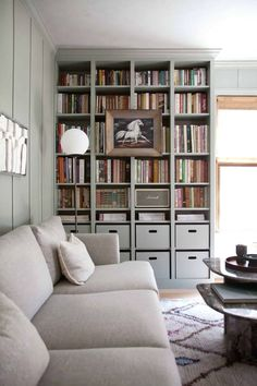 This DIY built-in Billy #bookcase project gave me an affordable way to create a custom-cabinetry feel for our home library. I had seen many an IKEA Billy Bookcase hack out in the blogosphere, so I knew how good those composite and laminate shelves could look after a little dressing up. Check out this before and after!