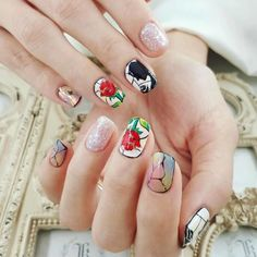 This Beauty and the Beast nail look is so whimsical. I love all of the different designs going on!