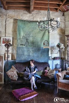 home of artist, Claire Guiral, Bordeaux, France. There are a lot of elements I like about this room. The furniture, color schemes, the wood flooring and stone.