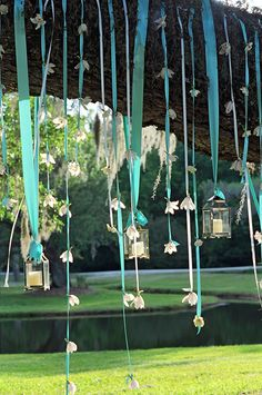 I really like the trend for hanging votives from ribbons