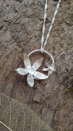 Sterling silver flower pendant set with a moonstone