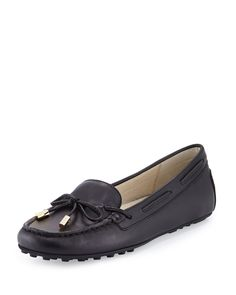 31b50d9ad45 Michael Kors leather moccasin slip-on. Round toe. Notched loafer vamp. Tonal
