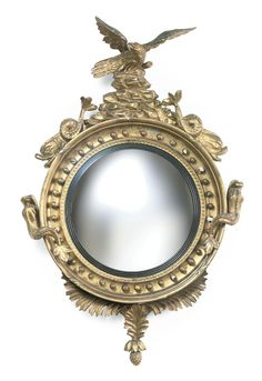 A REGENCY GILTWOOD AND EBONIZED CONVEX MIRROR -  EARLY 19TH CENTURY