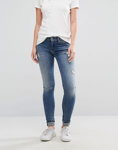 Get this Hilfiger Denim's skinny jeans now! Click for more details. Worldwide shipping. Tommy Hilfiger Denim Nora Mid Rise Skinny Jean - Blue: Jeans by Hilfiger Denim, Stretch denim, Mid-rise waist, Concealed fly, Distressed detailing, Skinny cut, Skinny fit - cut closely to the body, Machine wash, 92% Cotton, 4% Elastane, 4% Polyester, Our model wears a UK 8/W26 L32 and is 173cm/5'8 tall. Bringing a fresh edge to the Tommy Hilfiger empire, Hilfiger Denim, teams the traditional brand…