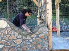 "COB mortar and cordwood log ends. For those who seek an alternative to portland based mortars, here is a good one. By using a 4"" bead of cob mortar on the inside and outside, the center cavity can be insulated and thereby improve the insulating factor of a cobwood wall. This one is being built in BC. Note the splits and rounds and the very well done random patterning."