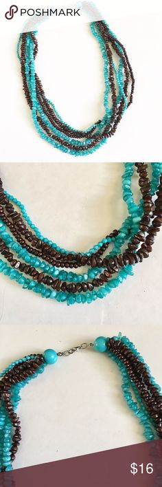 Brown and turquoise necklace Brown and turquoise multi-string necklace. All attached. Lobster claw closure. Jewelry Necklaces