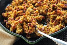 Andouille Cornbread Dressing This recipe is adapted from the book Emeril's New New Orleans Cooking and it's delicious and easy to make.  Though there is nothing like serving it hot from the oven, it can also be made a ahead of time for easy entertaining.