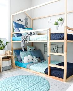 Gorgeous boy room - boys bedroom ideas and inspiration - bunk beds, bunks that are low down for kids to climb. Blue colour theme. Cushions galore!